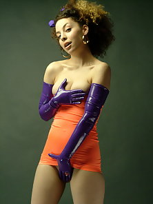 Zee wearing a retro spandex dress and latex gloves