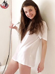 Hot brunette teen in a white t-shirt but without her panties having fun in the bathroom