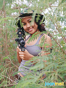 Asian Commando with Gun Shows Her Natural Tits in Jungle