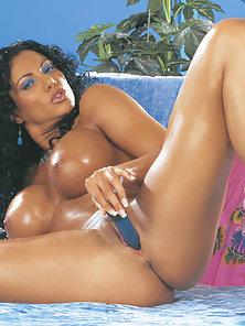 Hot exotic looking babe uses blue dildo on herself