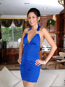 Sexy Anilos wife wears a glamorous dress that flaunts her long legs