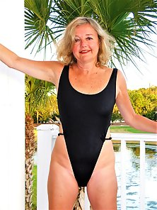Mature lady shows her hairy pussy and various lingerie