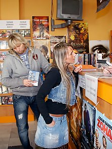 Cute and sexy babe drinks a load of sperm in the video shop