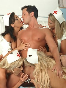 Four sexy nurses in stockings attempt to save a man from his erection