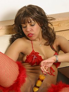 Stunning black chick in red stockings with dildo