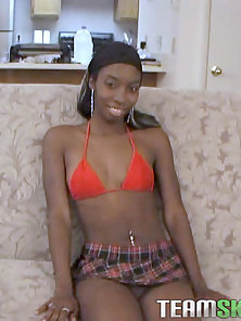 Skinny Ebony girl spreads her teen pussy and shoves a big fat vibrator in it and plays with herself