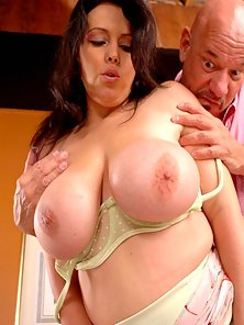 Milf Angelica squeezes a cock with her huge tits