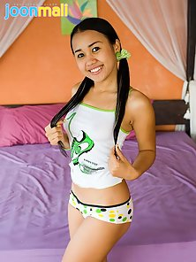 Asian Pigtail Babe Takes Off Tops and Shows Her Small Tits