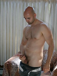 Hot bald gay Bucky masturbating his large pecker on the couch