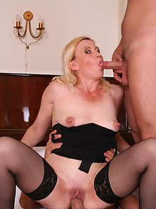 Lusty blonde mommy lets two studs bang her