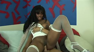 Nasty ebony in high heels and stockings takes on white penis