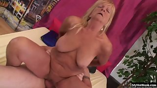 Blonde granny gets a dildo in her pussy before stud drills her hard