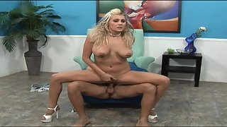 Blonde in high heels takes care of man's dick