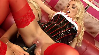 Blonde bombshells are having sex with a strapon