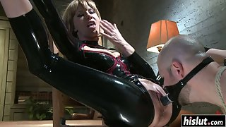 Latex Dress Wearing Mistress Gets Fucked by Dildo Attached to her Slaves Face