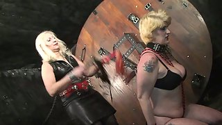 Blonde Slave with Big Boobs Wrapped by Female Mistress for BDSM Sex