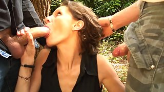 Skinny amateur slut gets anally fucked by two cocks outdoors