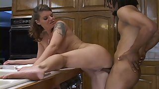 After Blowjob on her Knees a Stunning Babe Enjoys Being Bent Over the Kitchen Counter