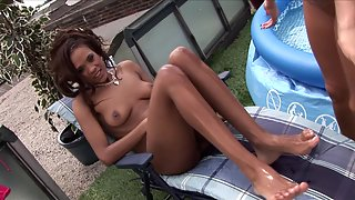 Two sluts playing with toys in the backyard