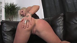 Tattooed Lady Screwed by Huge Dildo on Black Couch