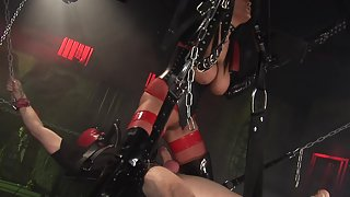 Domina bounds her slave and sucks him off
