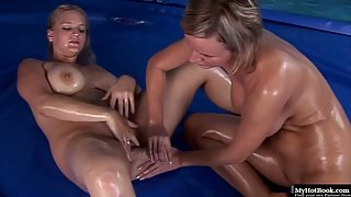 Naughty oiled babes using their tongues and fingers for fun