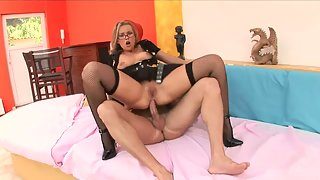 Dressed blonde slut riding her ass on a big cock