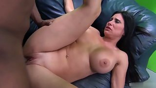 Black haired babe with huge boobs rammed by a big black cock
