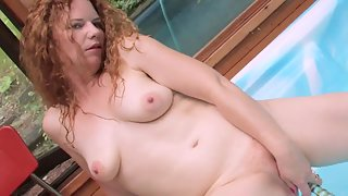Tattooed Girl Puts Huge Dildo in Her Pink Pussy Near Pool